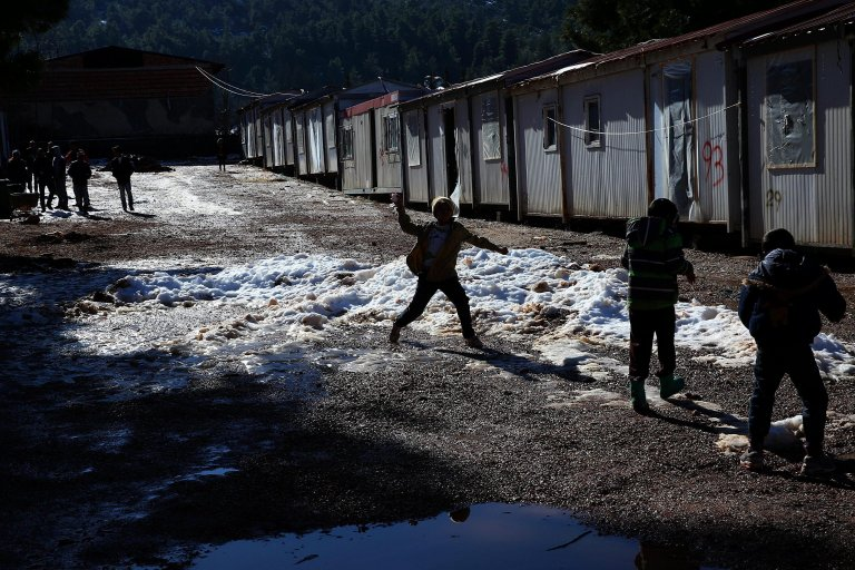 Refugee kids playing with the snow in Malakasa camp in Greece | Photo: EPA/Orestis Panagiotou