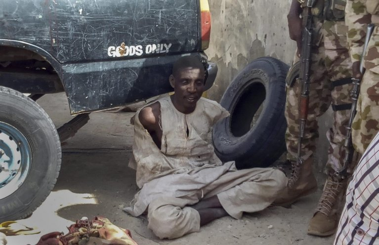 Nigerian troops detain a suspected Boko Haram militant in Rann, Nigeria | Photo: EPA/STR
