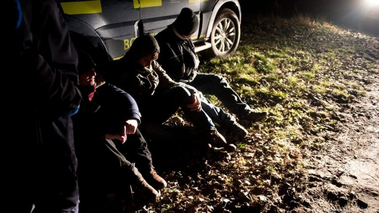 Afghan migrants detained by Hungarian police after being caught on the Hungarian-Serbian border in 2015 Photo: EPA/Szilard Koszticsak