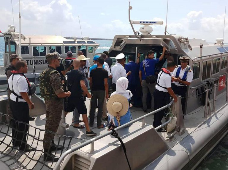Group of migrants of the Sarost 5 docking in the port of Zarzis. CREDIT: IOM