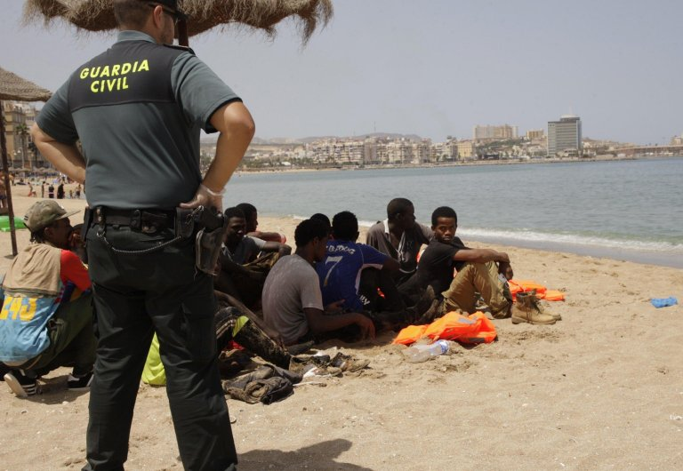Picture: Sub-saharan migrants rest on a beach of Melilla, a Spanish enclave in North-Africa (archive). Copyright: ANSA