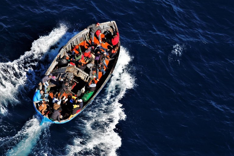 Boat with migrants photographed from a finance police helicopter about seven miles off Lampedusa on February 19, 2021 | Photo: Carmelo Sucameli/ANSA