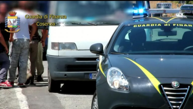 A still-frame from a video by the Cosenza finance police shows a lorry carryign irregular migrants 'employed' by a gangmaster to work on farms on the Sibari plain stopped by police