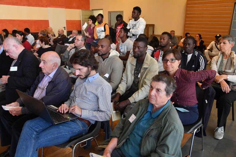 "Migrants during a conference promoted by the migrant rights campaign ""I Was a Foreigner"" 