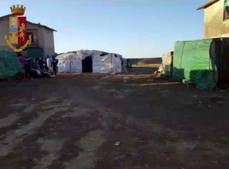 A camp where the migrants, who were forced to work in 'brutal and inhumane' conditions, were living | Credit: POLIZIA DI STATO/ANSA