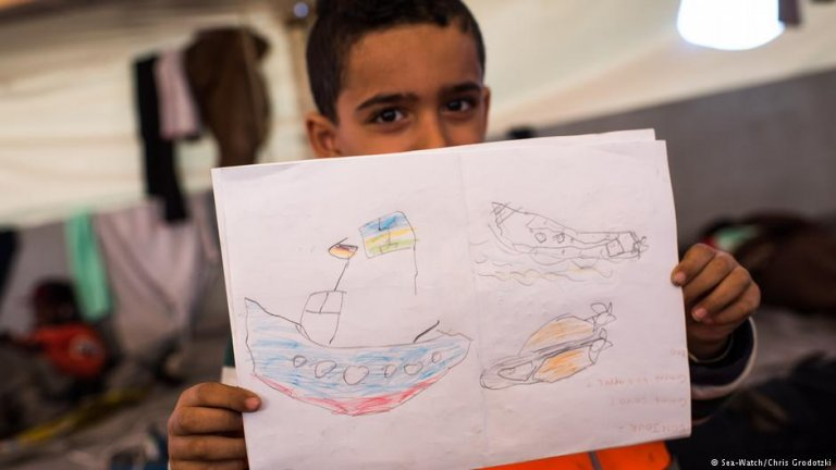 Child on board the migrant rescue ship | Photo: Sea-Watch/Chris Grodotzki