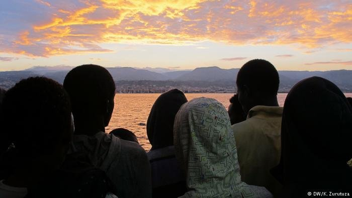 Migrants overlook the Mediterranean sea