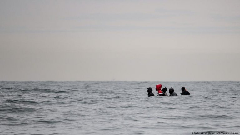 Migrants sit in a boat navigating the waters in the English Channel off the coast of northern France   Photo: Salmeer Al-Doumy/AFP/Getty Images