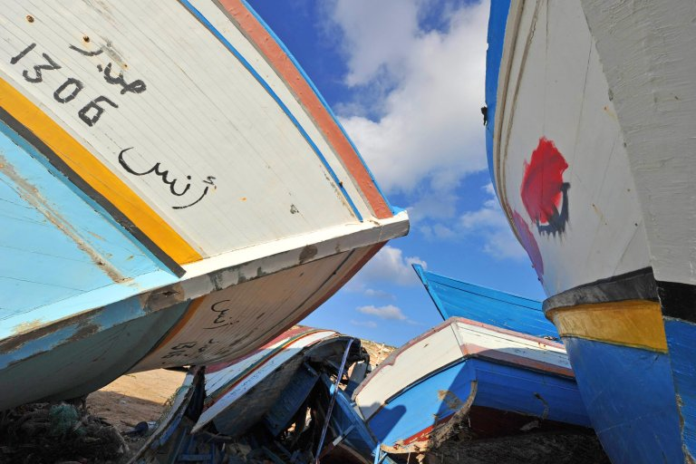 The hulls of abandoned boats on Lampedusa after having brought migrants to the island   Photo: ANSA/Ciro Fusco