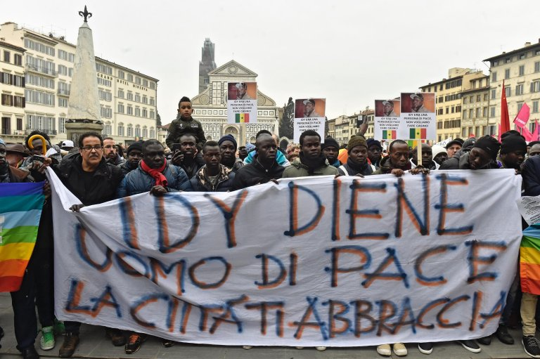 """The banner says """"Idy Diene, man of peace, the city hugs you"""" 