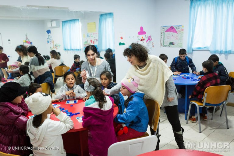 Classes at the KEDU center on the Greek island of Kos. Students play a word association game with their teachers. | Photo: UNHCR / Achilleas Zavallis
