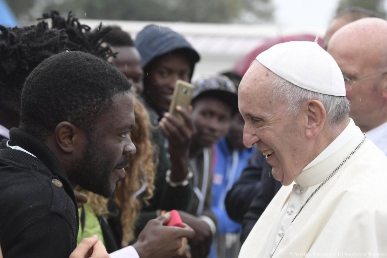 Pope Francis meets with migrants at a regional Migrant Center, in Bologna, Italy ANSA/L'Osservatore ROMANO Oct 1. 2017