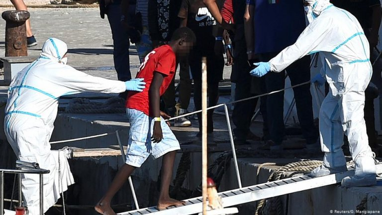 An unaccompanied minor from the Open Arms migrant rescue ship disembarks from the vessel | Phot: Reuters/G.Mangiapane