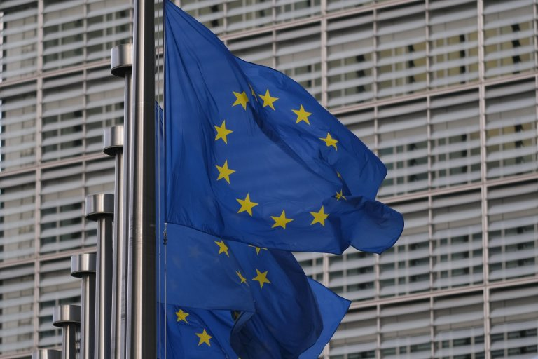 EU flags next to the European Commission in Brussels, Belgium | Photo: EPA/Julien Warnand