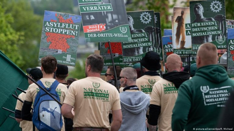 """Members of the ultra-nationalist party """"Der Dritte Weg"""" march at a protest in Plauen, Germany on May 1, 2019 