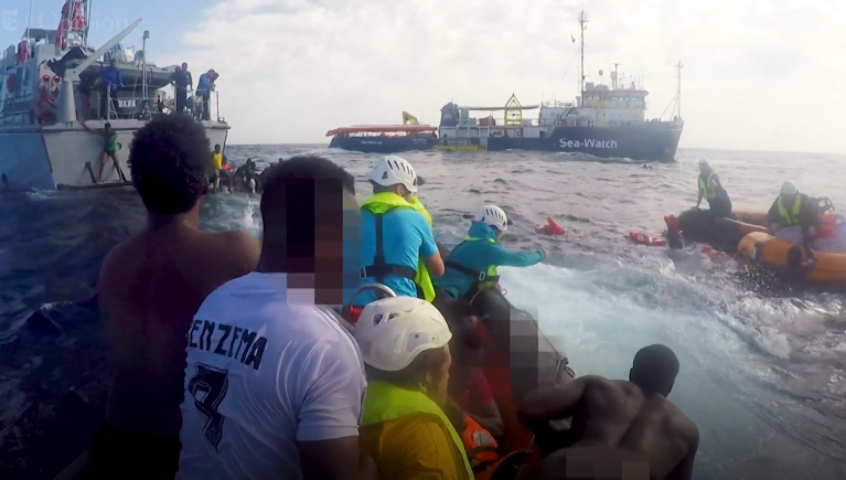 Snapshot of a video produced by the New York Times about the fatal attempt of migrants to cross the Mediterranean in November 2017. A Libyan coast guard vessel is seen in the top left corner | Credit: New York Times/Sea-Watch