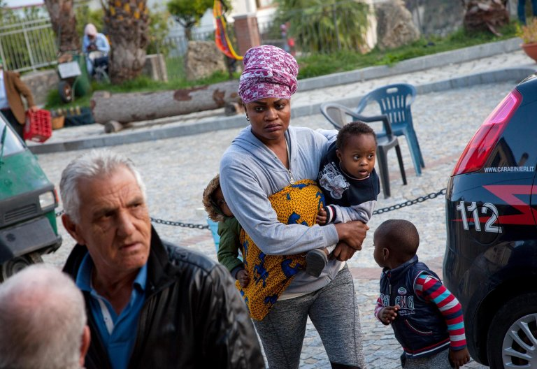 A mother and her children in the southern town of Riace, considered a model of integration for migrants.PHOTO/ANSA/MARCO COSTANTINO