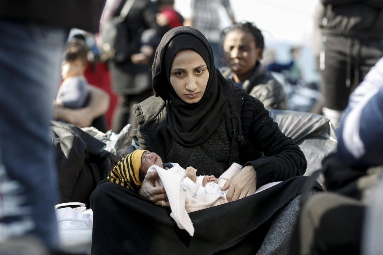 "A Syrian refugee mother holds her newborn baby after disembarking from the ferry ""Paros Jet"" upon their arrival from Samos Island at the port of Elefsina near Athens, Greece on October 22, 2019 