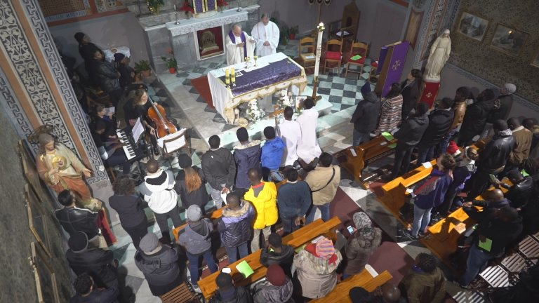 Funeral mass for Jean-Paul, a 24-year-old Cameroonian migrant, at the Church of St Mary's Assumption in Lesbos, Greece. Photo: Claire Paccalin, January 19, 2019