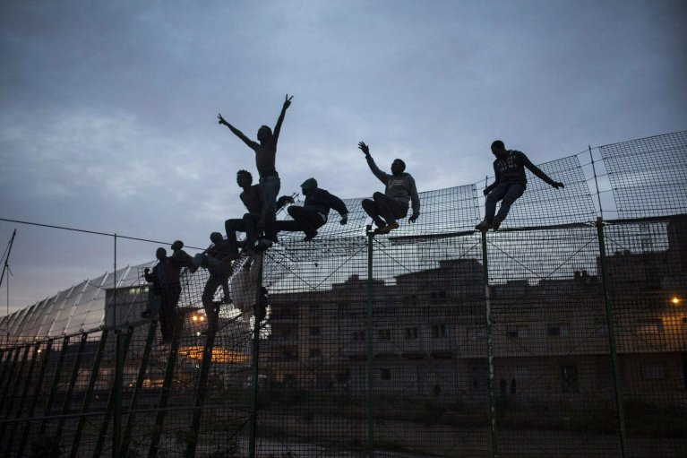 From file: migrants on the fence between Morocco and Melilla, Spanish enclave on the north of Africa, as they shout crying for help and asking for refuge. | Credit: EPA/SANTI PALACIOS