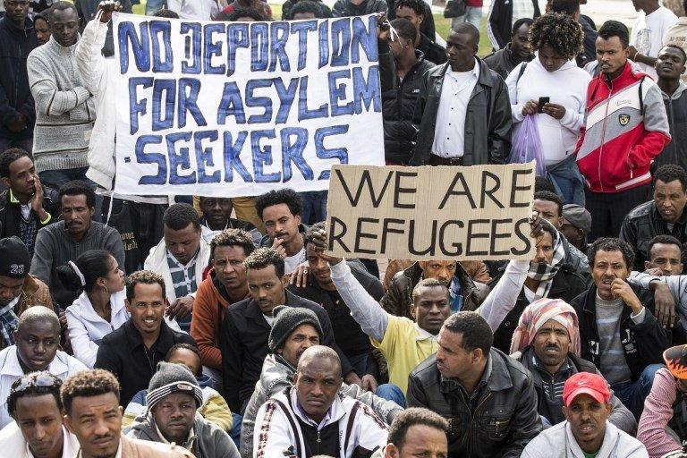 Les migrants érythréens en Suisse protestent contre les expulsions   Crédit : Jack Guez/AFP