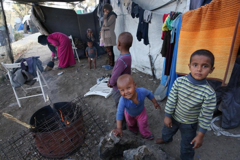 Refugee children playing outside their tent in a makeshift camp that is set outside the refugee camp of Moria, on the Lesvos island, Greece. Credit: EPA/ORESTIS PANAGIOTOU