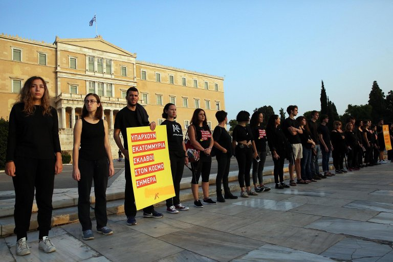 """Activists take part take part in a rally titled """"Walk for Freedom"""" in protest against human trafficking, in Athens, Greece 