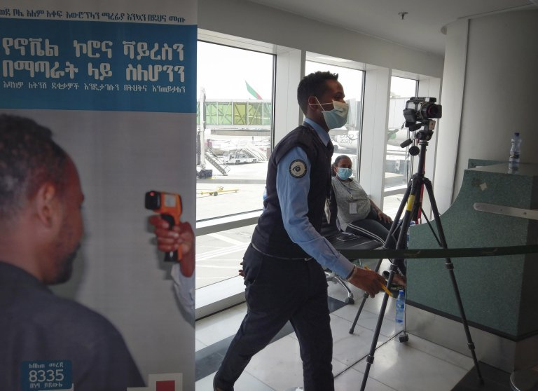 An Ethiopian official working at a screening point for the coronavirus at Bole International Airport in Addis Ababa, Ethiopia | Photo: EPA/Stringer
