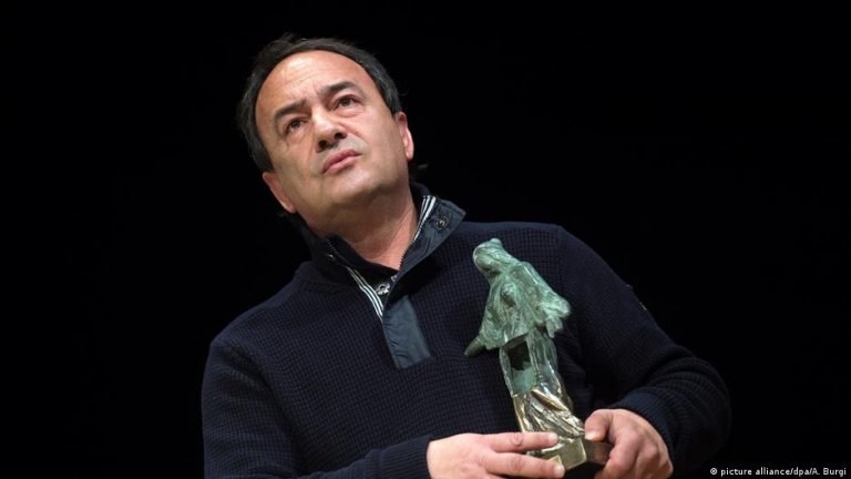 Lucano was hailed as a visionary for using integration as a motor for revitalizing his dying Italian village | Photo: picture alliance/dpa/A. Burgi
