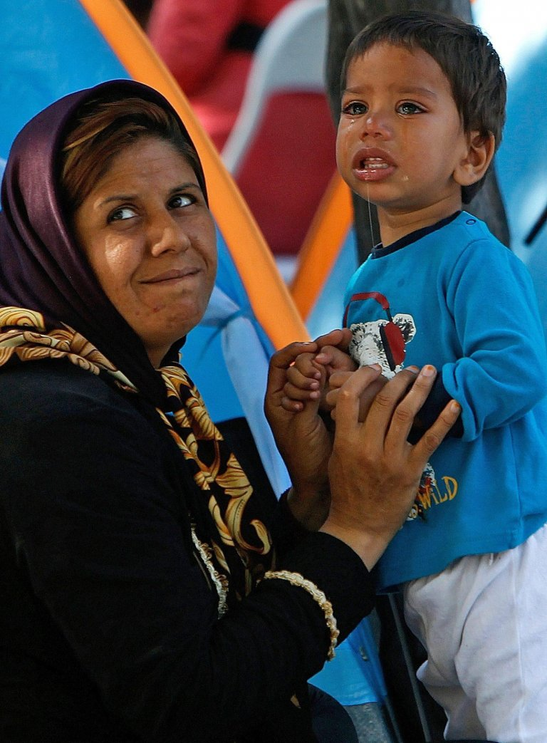Picture shows a foreign mother and her child PHOTO/EPA/ARCHIVE