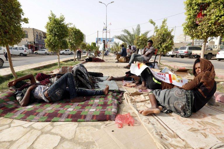 African migrants resting beside a road in the eastern city of Marib, Yemen | Credit: ARCHIVE/EPA/YAHYA ARHAB
