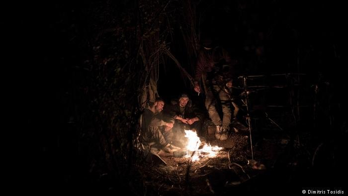 Dragan (center), a Macedonian migrant, is hidden in the forests near the Serbian-Croatian border, as he tries to cross to central Europe with other migrants from Arab countries. Dragan, along with one Chinese migrant, is an oddity among the hundreds of Syrians and Afghans stranded in Šid, Serbia
