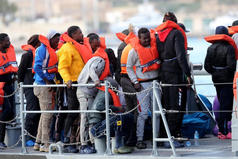 Migrants disembark from the Armed Forces of Malta vessel P51 | Photo: EPA/DOMENIC AQUILINA