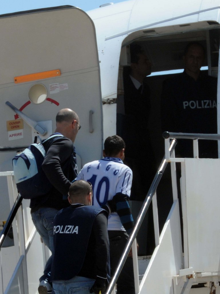 Migrants being repatriated board a plane in Lampedusa Credit: ANSA