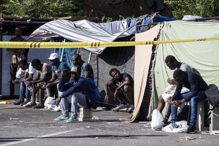 Migrants near Tiburtina railway station in Rome, Italy   Photo: ANSA/Massimo Percossi