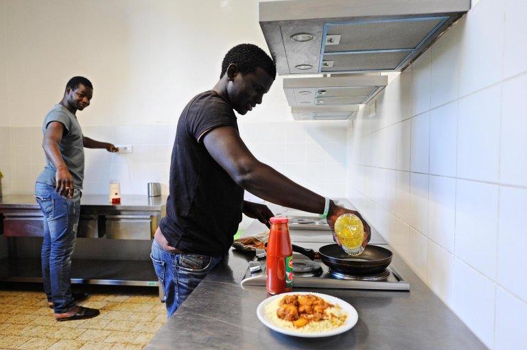 Immigrants at a hosting center |PHOTO: Archive/ANSA/Maurizio Degl'Innocenti