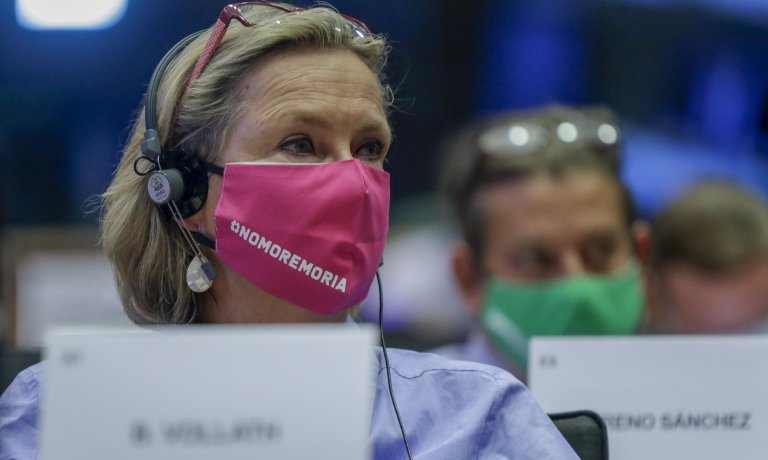 """Members of European Parliament protest by wearing masks that say """"#nomoremoria"""" during a hearing by the European Parliament committee on the new pact for migration and asylum at the European Commission in Brussels, Belgium, 24 September 2020 