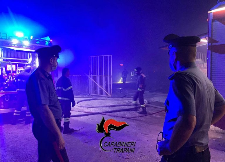 A freeze frame from a police video of the fire at the migrant camp in Castelvetrano, Italy   Photo: ANSA/Carabinieri