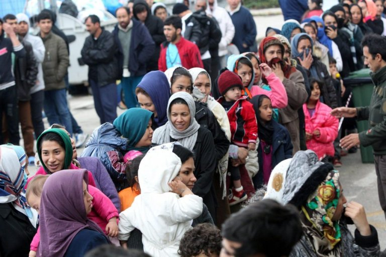 Refugees waiting in line for processing