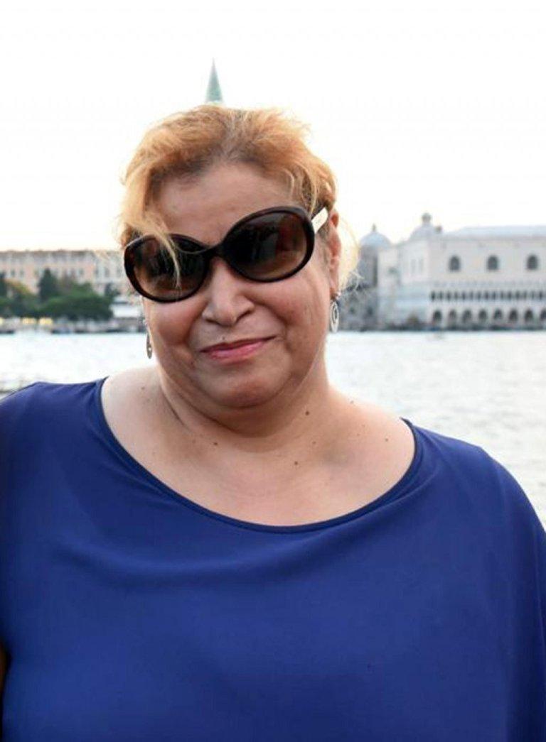 ANSA / صورة الطبيبة السورية سمر سنجاب التي توفيت في إيطاليا بعد إصابتها بفيروس كورونا وهي تعاج المرضى في إيطاليا / حقوق الصورة / أنسا