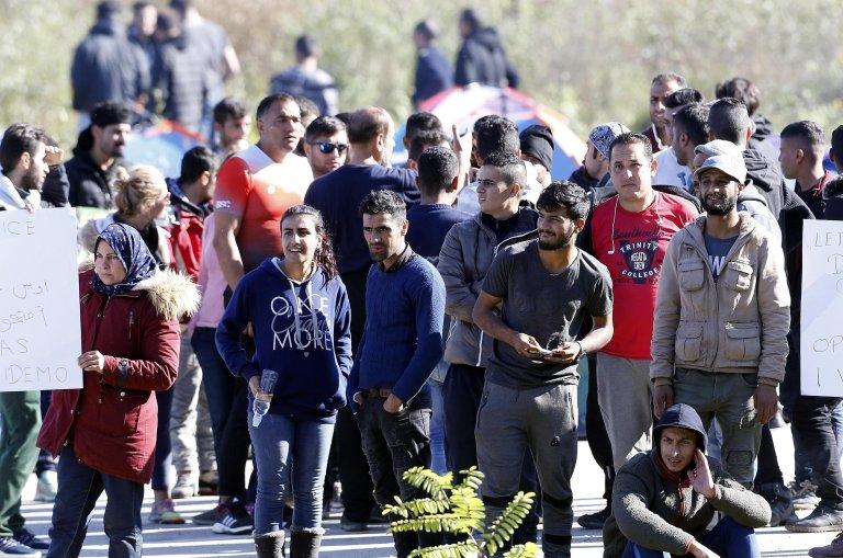 A group of migrants attempting to cross into Croatia gather near the Maljevac border crossing, Bosnia and Herzegovina   Photo: EPA/FEHIM DEMIR