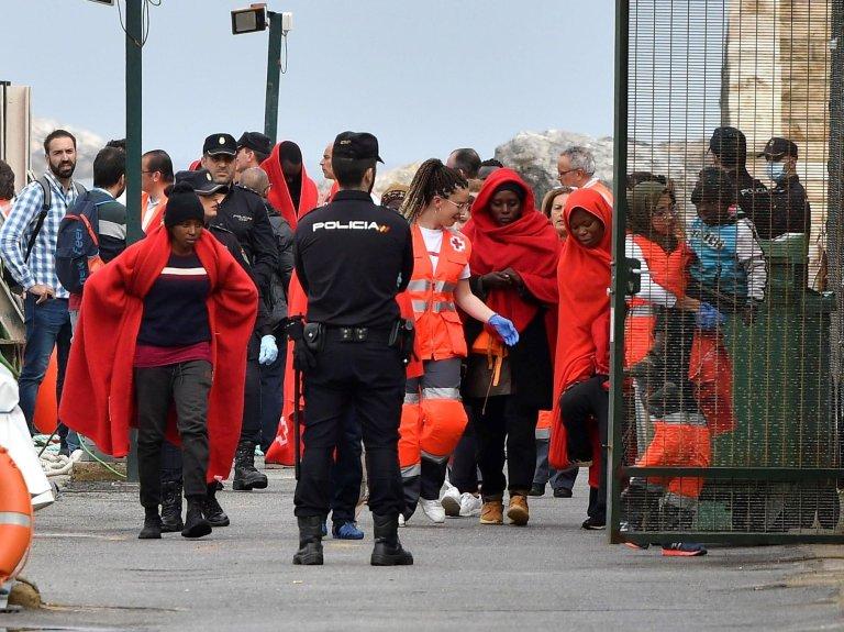 Migrants in Almeria, Spain, after being rescued - Credit: EPA/CARLOS BARBA