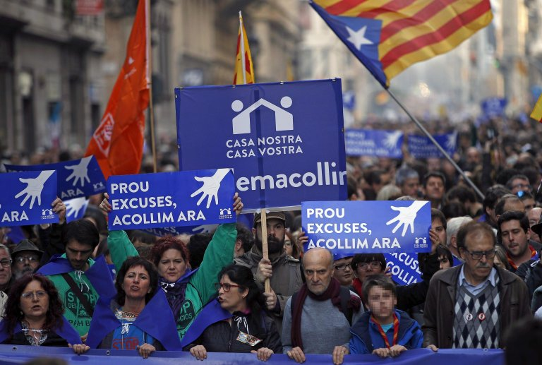 A rally to call for the reception of migrants and refugees in Barcelona, part of the the campaign 'Casa Nostra, Casa Vostra' (Our Home, Your Home). Credit: EPA/ALBERTO ESTEVEZ