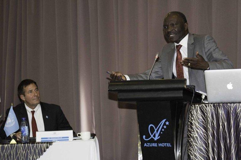 Kenya's principal secretary for immigration Gordon Kihalangwa making the keynote address. Credit: IOM