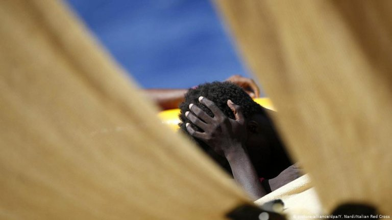A migrant rescued from waters between Malta and Libya Photo: Picture-Alliance/Y. Nardi/ Italian Red Cross