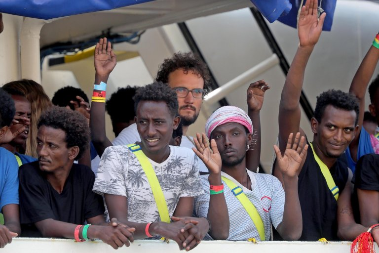Migrants on board the Aquarius ship as it enters the Grand Harbor in Senglea, Valletta, Malta. Credit: EPA/DOMENIC AQUILINA