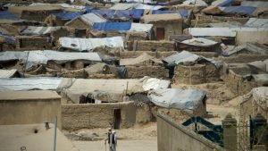 L'Afghanistan enregistre au 30 novembre un nouveau record de plus d'un demi-million de civils déplacés depuis le début 2016 fuyant la violence et les combats (photo du camp de Bagrami prise en 2012). Crédit : AFP / Johannes Eisele