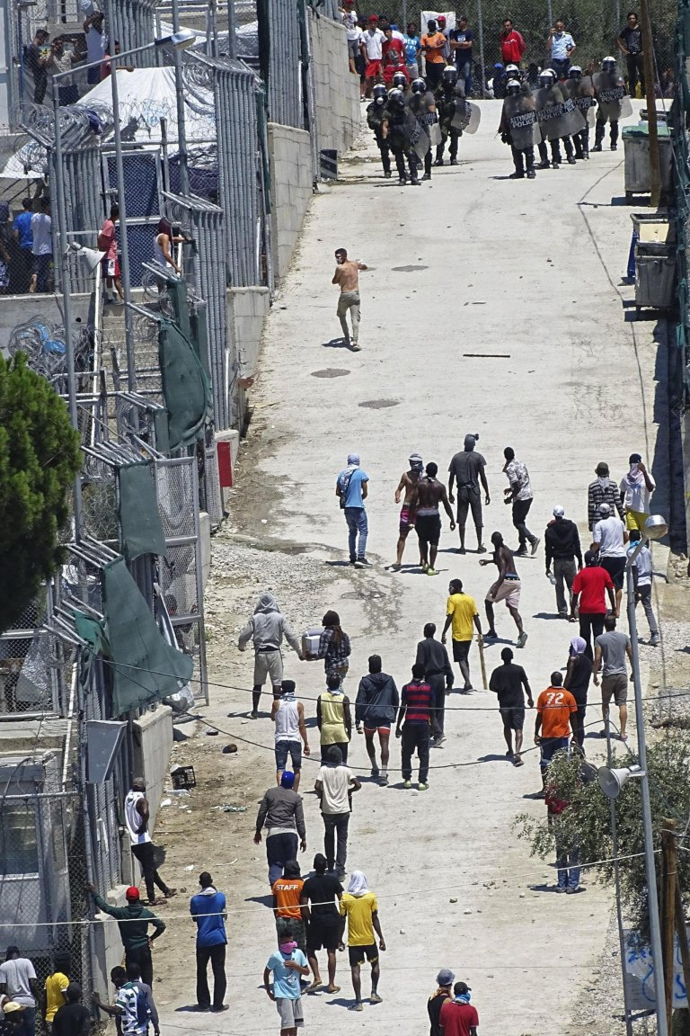Migrants clash with riot police while protesting to demand better living conditions at the Moria asylum center on Lesvos Island, July 18, 2017. Credit: EPA/STRATIS BALASKAS