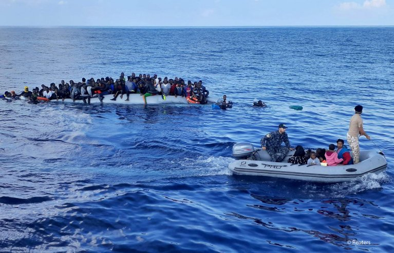 From file: Migrants on a rubber dinghy are pictured during a rescue operation, off the coast of Libya in the Mediterranean Sea, November 13, 2020. Picture taken November 13, 2020   Photo: REUTERS/Stringer