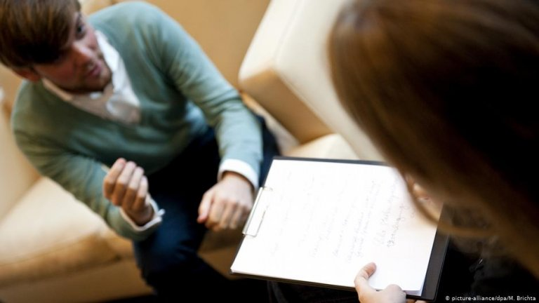 A young man talking to a therapist